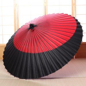 赤と黒の月模様の和傘